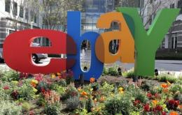 US auction site eBay has announced a new partnership with China Post and the US Postal Service