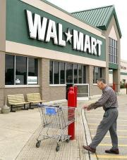 US retail giant Wal-Mart plunged into the online video market on Monday