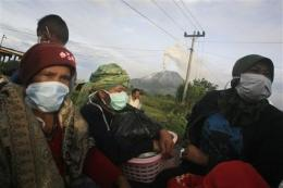 Villagers return to slopes of Indonesian volcano (AP)