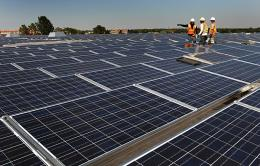 Wokers finish installing solar panels in Colorado