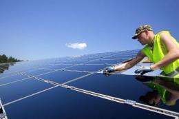 Worker assembles solar panels