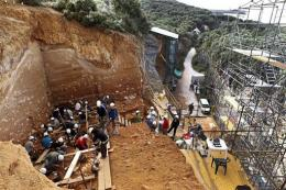 Workers carry out an excavation at the Atapuerca archaeology site in July