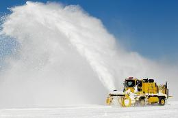 Workers remove snow from a runway at O'Hare International Airport on February 3