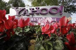 Yahoo's 4Q earnings double, revenue falls 12 pct (AP)